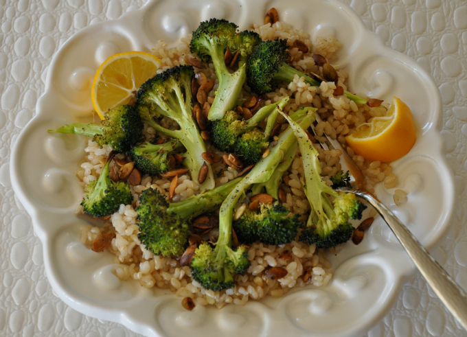 roasted broccoli and pumpkin seeds over brown rice
