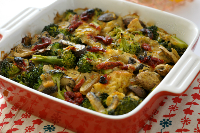 A creamy broccoli casserole with mushrooms, Italian bread and sun-dried tomatoes. (#vegan) ordinaryvegan.net